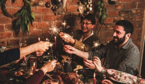 Family celebrating New Year holiday with festive dinner at home